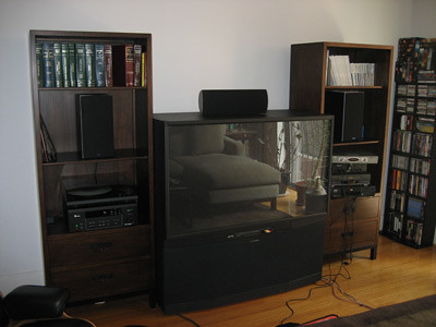 HDTV, bookshelves and stereo system