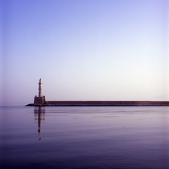 sunrise in Chania harbor - lighthouse - by refractionless