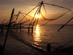 Chinese Fishnets-6-IMG_0622 (sanmang610) Tags: sunset red sea sky orange india seascape reflection beach nature water colors vertical clouds landscape golden ray colours streak chinese peaceful fishnet kerala pole shade serene poles nets isawyoufirst