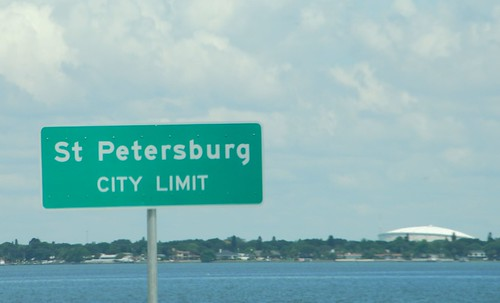 Distant picture of the Trop with a city limits sign for St. Pete