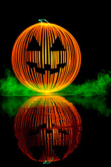 The Great Pumpkin (TxPilot) Tags: longexposure light lightpainting reflection art halloween painting pumpkin paint jackolantern orb led lap paintingwithlight movinglights balloflight elwire lightpaint lightemittingdiode electroluminescentwire lightartphotography
