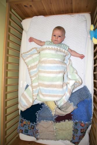 Damien in his Crib
