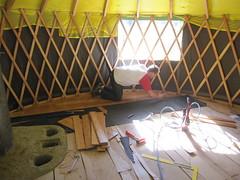 installing the bamboo floor (fishermansdaughter) Tags: yurt cob floorheater heatingwithwood rocketmassheater unconventionalwoodstove cleanburningwoodstove selfbuiltstove