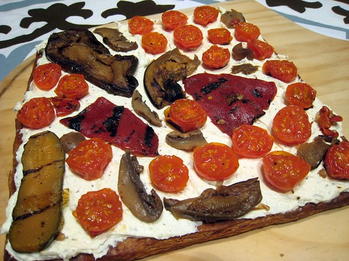 Uncut roasted vegetable tart.
