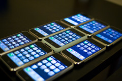 A line up of nine iPhones