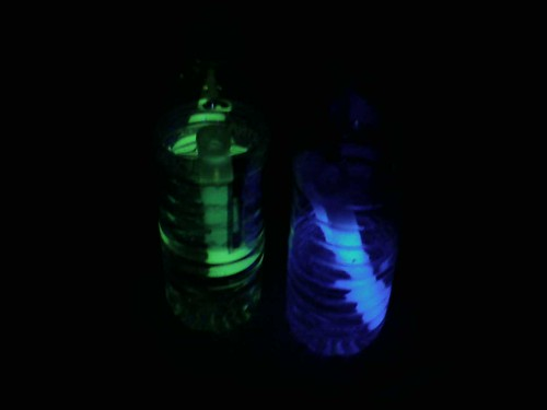 blue and green glowing water bottles