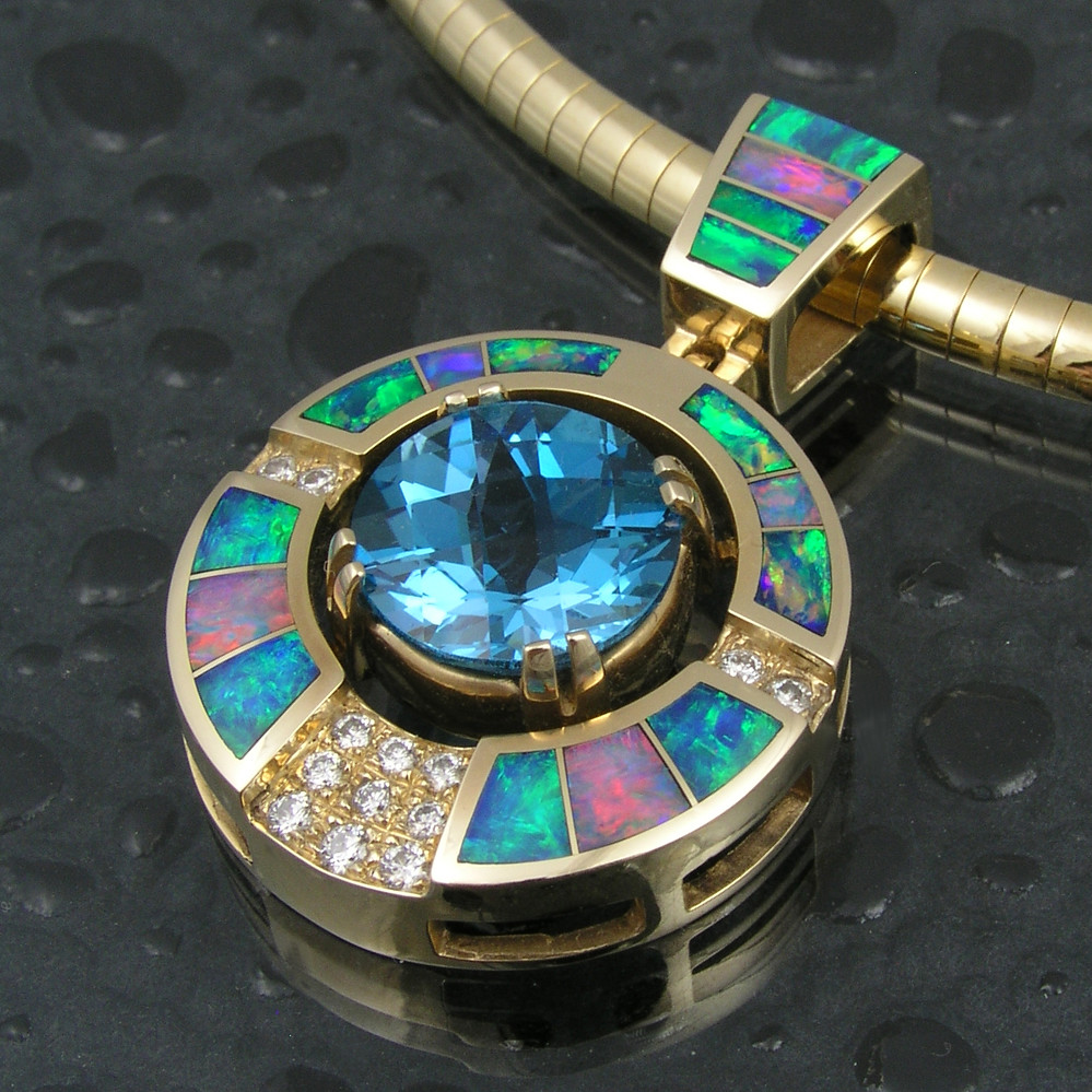 Australian opal inlay pendant with blue topaz and diamonds