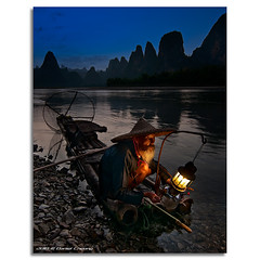 Fisherman's Blues (DanielKHC) Tags: china old travel blue light people mountain mountains net lamp face hat digital river dark beard landscape 1 li boat interestingness high fishing fisherman nikon rocks dynamic guilin yangshuo traditional scenic dramatic front bamboo explore page oil cormorant raft lantern petrol karst range fp dri hdr blending  guanxi d300 xingping  danielcheong danielkhc tokina1116mmf28