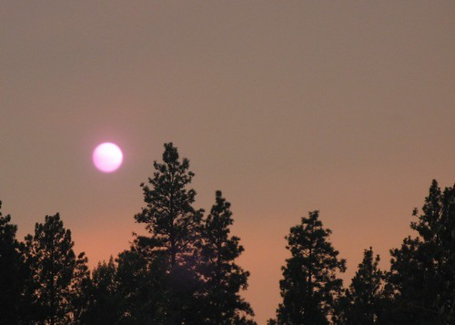 Setting sun, obscured by red smoke