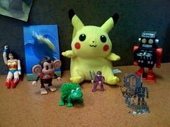 woman work wonder toys monkey robot desk ninja pikachu