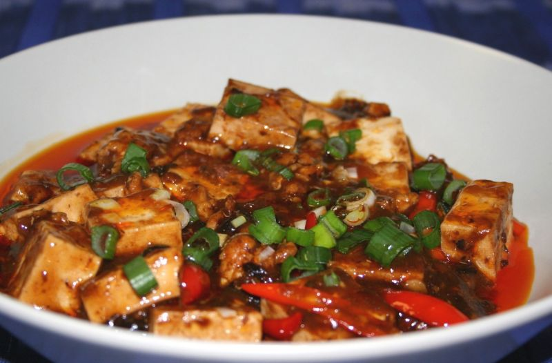 ... mapo tofu let it boil down so the sauce pin it garnished mapo tofu
