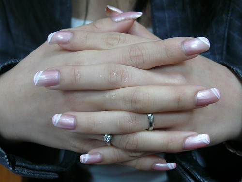 Long finger nails metallic pink design