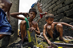 Smoky Mountain - Together Scavenging for Ink Cartridges (Mio Cade) Tags: poverty boy mountain toxic ink kid child philippines environmental social powder manila smoky recycling scavenger cartridge dispose tondo scanvenging