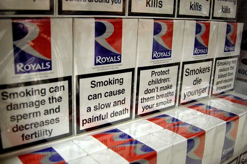 smoking packs of cigarettes with health warning smoking can cause a slow and painful death