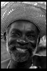 Greatest smile in Haiti (LindsayStark) Tags: travel portrait blackandwhite men haiti war conflict humanrights humanitarian humanitarianaid emergencyrelief waraffected
