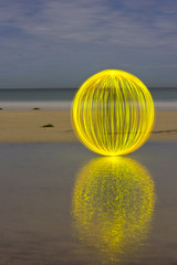 Ball of Light - Home Again (biskitboy) Tags: ocean longexposure sea sky orange lightpainting color reflection art beach water yellow night clouds ball circle sand waves bright sandy orb balls australia sphere round adelaide orbs southaustralia grange tennyson balloflight brightcolour lightjunkies colourbrightcolors