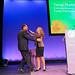 Maria Shriver hugs Tony Robbins