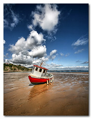 Beached boat ( HDR) (blueeyeddebby) Tags: uk beach clouds boat sand tenby hdr wfc interestingness299 buoyant platinumphoto youvsthebest platinumheartaward thepinnaclehof