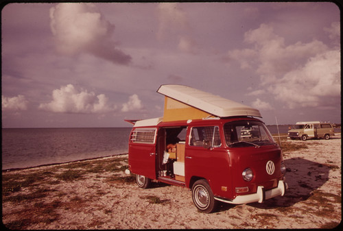 1970s Volkswagon bus parked on beach