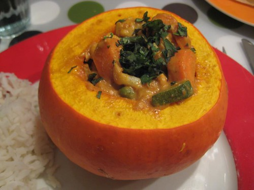 Indian vegetable curry with cashews served in pumpkin