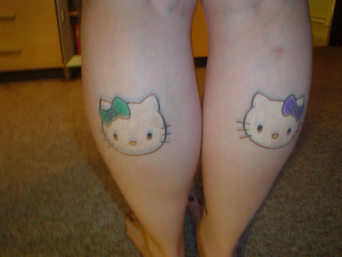 my hello kitty tattoos. i got them on my 30th birthday. the green bow has a