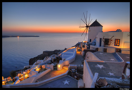 A lone windmill standing lookout at Oia
