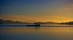 The Lonely Boat at Sunset (Z0L1TA) Tags: sky mountains water clouds scotland boat lochlomond allrightsreserved blueribbon luss naturesfinest sigma1770mm canon400d zolita1908 wwwzolitacouk thelonelyboatatsunset photographybyzolitamcguicken© ɀ photographybyzolitamykytyn© zolitamykytyn zolitaphotography httpzolitaphotographywixcomzolita ɀolita