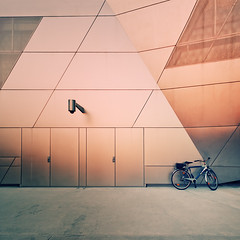 Left Alone With Big Brother (Philipp Klinger Photography) Tags: world camera light sunset shadow sun detail lines bike bicycle wheel metal architecture facade germany munich mnchen bayern deutschland bavaria nikon triangle europa europe geometry metallic oberbayern wheels cctv minimal cycle bmw bigbrother philipp minimalistic fahrrad kamera bayerische welt klinger motoren werke bmwwelt bmwworld bayerischemotorenwerke d700 dcdead vanagram fotosmagnficas formasperfectas