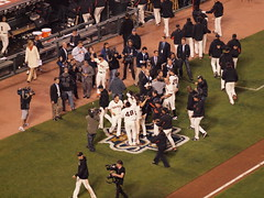 Giants celebrate victory outside of the dugout with cameramen recording (Eric Broder Van Dyke) Tags: sanfrancisco outside baseball victory playoffs giants celebrate dugout recording cameramen nlcs