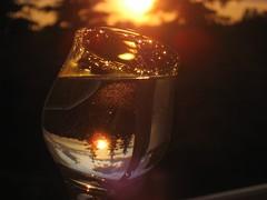 Amber lights (peggyhr) Tags: sunset sky sun canada water glass clouds golden droplets edmonton silhouettes diamond alberta albertaskies supershot peggyhr showoffyourbodyofwork