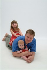 Rachel, Colin and Daddy laying on the floor