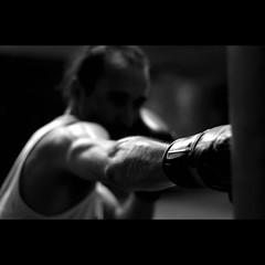 the art of muay thai boxing I. (chris spira) Tags: china portrait bw sport shanghai arm fist thai passion boxer series boxing shanghaiist muay nationalgeographic traing