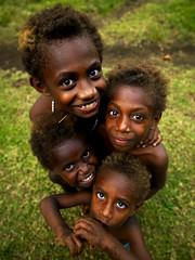 Vanuatu kids smiling (Eric Lafforgue) Tags: tourism smile smiling vertical kids children outdoors island happy kid eyes child pacific joy culture ile wideangle tribal hasselblad explore pacificocean blackpeople enfants tradition tribe circumcision ethnic levistrauss archipelago hebrides ethnology vanuatu tribu fourpeople oceania kustom nivanuatu ebridi melanesia fourkids claudelevistrauss kastom newhebrides h3d oceanie lafforgue malekula bignambas traveldestination 0046 nambas ethnie ericlafforgue cannibalisland melanesie nouvelleshebrides ericlafforguecom vanuatupicture vanuatupictures ocania  hebridennouvelleshbridesnuevas