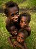 Vanuatu kids smiling (Eric Lafforgue) Tags: tourism smile smiling vertical kids children outdoors island happy kid eyes child pacific joy culture ile wideangle tribal hasselblad explore pacificocean blackpeople enfants tradition tribe circumcision ethnic levistrauss archipelago hebrides ethnology vanuatu tribu fourpeople oceania kustom nivanuatu ebridi melanesia fourkids claudelevistrauss kastom newhebrides h3d oceanie lafforgue malekula bignambas traveldestination 0046 nambas ethnie ericlafforgue cannibalisland melanesie nouvelleshebrides ericlafforguecom vanuatupicture vanuatupictures ocania バヌアツ hebridennouvelleshébridesnuevas