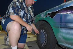 Checking my Tire Pressure (Paul McRae (Delta Niner)) Tags: travel art love beauty america al dragon alabama happiness tire adventure mustache kneeling hubcap gauge americathebeautiful artcar hawaiianshirt searching anniston tirepressure handlebarmoustache dragonfire ilikeit roadtriptomtdora highwaysongs leavinganniston dragonwatches