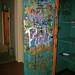 Camp House storage closet employee graffiti (left door)