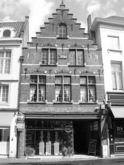 Immaculately intact. (davidezartz) Tags: california travel windows light shadow sky blackandwhite bw sunlight white signs black building monochrome architecture clouds grey nikon europe belgium belgique pavement brugge crowsnest shops bruges signboard ohhh blackdiamond magicalmoments intact 4b williamshakespeare sirfrancisdrake immaculately franshals potplants e3100 blueribbonwinner thegalaxy nikone3100 bej nikonstunninggallery dutchpainter mywinners anawesomeshot impressedbeauty flickrdiamond citrit theunforgettablepictures platinumheartaward flickrestrellas quarzoespecial rubyphotographer damniwishidtakenthat dragondaggeraward however~itsstillmylife qualitystructuresppf immaculatelyintact erected1579 43centuries queenelizabetthefirst