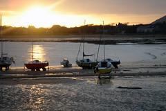 Ely Bay (pigsinspaces) Tags: uk sunset reflection beach boats coast scotland dock sailing sundown 2006 quay shore april lowtide quayside vogonpoetry elybay