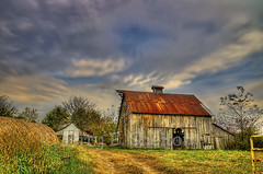 Cooper County Barn (Uncle Phooey) Tags: old autumn fall barn rural shed scenic rusty missouri weatheredwood hdr tinroof barnyard oldbarn coopercounty 5exposures roundhaybales scenicmissouri