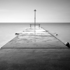 Minehead II (Adam Clutterbuck) Tags: ocean uk greatbritain sea england blackandwhite bw seascape beach monochrome square landscape mono coast blackwhite post jetty somerset bn coastal shore elements gb marker blogged railing bandw sq limitededition slipway exmoor minehead westsomerset greengage adamclutterbuck sqbw bwsq showinrecentset shortedition le50 limitededition50