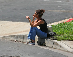 Curb side service...I'm waiting (MissionPhotography) Tags: california street woman cute girl fruits fashion hair cigarette jeans orangecounty nordstrom curb blend acai burnette monavie