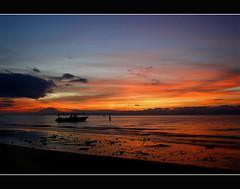Morning Glow (Jeremy-G) Tags: longexposure morning blue red sea sky detail beach silhouette clouds sunrise boat sand bravo glow searchthebest mountkinabalu 10sec magicdonkey flickrsbest pulautiga