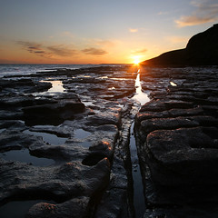 Southerndown Sunset (Adam Clutterbuck) Tags: ocean uk greatbritain sea seascape beach stone wales square landscape coast rocks coastal shore strata glamorgan gb sq oe southerndown dunraven greengage shorescapes adamclutterbuck showinrecentset walglamheri openedition