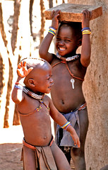 Himba children playing and dancing - Namibia (kryyslee) Tags: world pictures voyage africa trip travel portrait playing color travelling colors smile face smiling canon children photography eos photo gesicht foto tour child faces dancing image photos pics couleurs picture images tribal du adventure round around enfants tribe christophe monde backpacker amateur pict namibia autour couleur indigenous visage himba afrique tribu aroundtheworld aventure namibie visages tourdumonde 50d 400d himbas eos400d kryyslee christophepaquignon paquignon