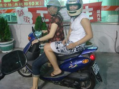 Becka and Rina on a moped