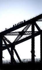 People crossing a bridge