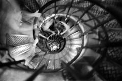 (flallier) Tags: nb bw noiretblanc blackandwhite blur flou trix 400tx kodak d76 nikonfe2 nikon film argentique paris escalier stairway arcdetriomphe photographieargentique escalerasstairs streetshot nikonfilmcamera spirale classicblackwhite nikonflickraward flickraward flickraward5 françoislallier yahoo:yourpictures=blackandwhite bnw mono monochrome