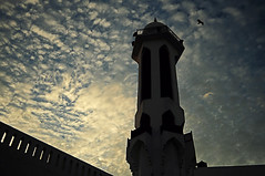 Minaret to heaven (Fawzan Hasan) Tags: red sky orange india bird tower silhouette stone wall clouds photography evening flying tank shot map balcony minaret islam overlay mosque explore filter speaker gradient levels newdelhi highpass scattered hasan fawzan adobephotoshopcs5