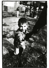 Iasi, Romania - 04/92 (tobydeveson) Tags: playing 35mm blackwhite dragon vampire naturallight running dracula communist communism devil fullframe transylvania gypsy uncropped kodaktmax400 gypsies draco rumania romanian drac orphanages havingfun roumanie slowshutterspeed nikomat nikkormat moldavia smallboy scannedprint roumania countdracula ceaucescu easterneuropean bramstoker blurmovement vladtheimpaler blurredbackground ottomanempire spinninground romnia rumanian darkroomprint wallachia vladdracul romn drakulya kazklvoyvoda elenapetrescu orderofthedragon sonofthedragon princeofwallachia vladepe vladiiitheimpaler drculea nicolaeceauescu impalerprince vladiii romanianorphans  postceaucescu primefixed24mmlens rumn eararumneasc voivodeofwallachia wladislausdragwlya drakwlya holdingontocamerastrap lookingdowncameralens