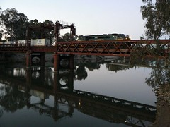 crossing the Murray at dusk (sth475) Tags: railroad bridge train river clyde gm diesel border railway loco bulldog nsw locomotive murrayriver coveredwagon streamliner aclass tocumwal cabunit railwayinfrastructure powerhousemuseumphotocompetition